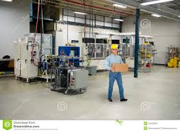man working in industrial manufacturing factory stock photo man working in industrial manufacturing factory stock photos
