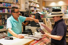 battling the mail order drug trend wally elovitch a s clerk at the apthorp pharmacy helps a customer her prescription drugs on the upper west side of manhattan on 18 2014