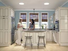 small space kitchen ideas: small kitchen with velux sun tunnel skylights