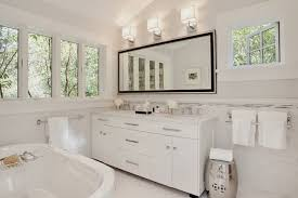 transitional bathroom by urrutia design bathroom lighting fixtures over mirror