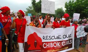 Former Nigerian Education Minister and Vice President of the World Bank     s Africa division   r L  Obiageli leads a march of Nigeria women and mothers of the