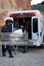 Image result for pictures of ambulance loading people