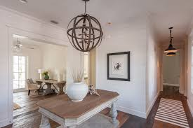 tongue and groove beach style entry colour schemes other metro beach style furniture black pendant lights crab art crown molding medium wood orb chandelier beachy style furniture