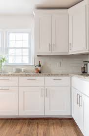 beautiful white kitchen cabinets: white shaker cabinets light wood floor and tan granite beautiful white kitchen