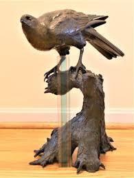 Imposing <b>cast iron</b> bird sculpture looks <b>Japanese</b>
