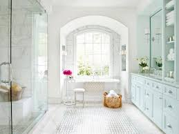 spa bathroom showers: elegant white marble bathroom with glass shower