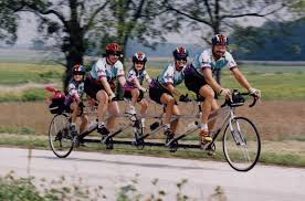 Family of five riding the same bike