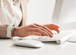 reverse recruiting hr professional emily taylor water w typing on keyboard