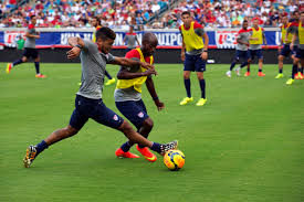 u s department of defense photo essay deandre yedlin left and damarcus beasley defenders on the u s men s national soccer