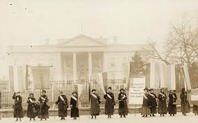 national w s party nwp members picket the white house during the silent sentinels protests in 1917 the banner reads mr president how long must women wait for liberty