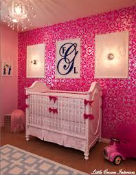 little crown interiors created this chic pink nursery the dramatic back wall is covered in hot pink and silver damask wallpaper baby nursery cool bee