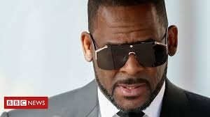 R. Kelly loses civil court case after missing hearing - BBC News