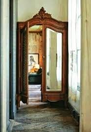 antique wardrobe reconfigured and re purposed as a secret doorway decor antique armoires antique wardrobes english