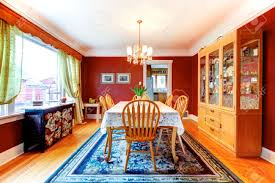 room hardwood floor rug red dining room with hardwood floor and rug furnishes with rustic wood