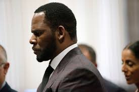 R. Kelly charged with bribing Illinois state official to be able to marry ...