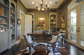 van wicklen design complete with a stag head and cowhide rug animal hide rugs home office traditional