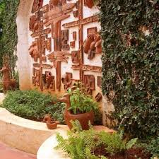 designs outdoor wall art: mediterranean outdoor wall art surrounded among greens on wall also planters surrounding for impressive exterior decor