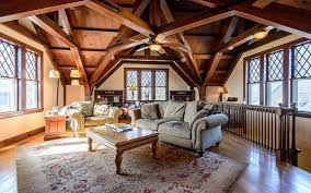 fascinating craftsman living room chairs furniture: craftsman living room with detailed open beam cathedral ceiling wood lattice framed windows and wood