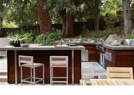 patio outdoor stone kitchen bar: stone patio bar kitchen bar stone home transitional with small fridge sloped