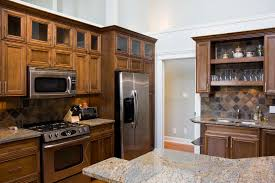 compact office kitchen modern kitchen. this compact space is detailed with patterned tile backsplash between layers of dark natural wood office kitchen modern d