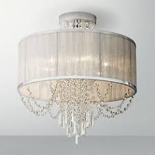 this silver organza shade and chrome ceiling light features clear crystal bead that radiate when illuminated bedroom light fixtures