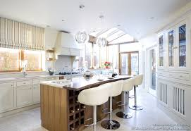 in style kitchen cabinets: kitchen color trends natural light floods into this luxury kitchen illuminating the soft white