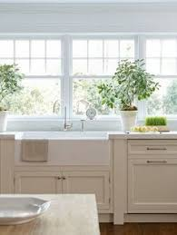 sink windows window love: white cabinets and a farmhouse sink love the big window