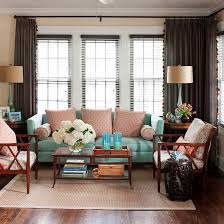 the homeowner took inspiration from her wardrobe favorites to outfit her fashion forward living room in muted spice tones with splashes of turquoise bhg living rooms yellow