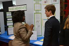 frcse employees judge science fair navair u s navy naval air ernestine lawson left judges a student s entry at the northeast florida regional science and