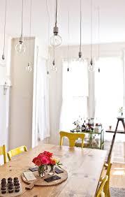 bare bulbs hang over dining table bare bulb lighting