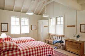 bathhouse example of a country guest bedroom design in san francisco with white walls bedroomformalbeauteous black white red