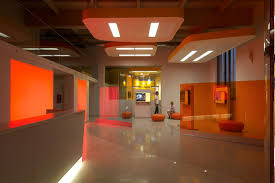 in turin italy the interior architecture is comprised of vivid color and embracing forms advertising office design