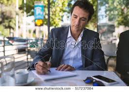 essay stock photos royaltyfree images amp vectors  shutterstock concentrate middle age businessman portrait writing an essay outdoors in rome italy