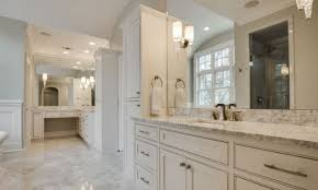 an alford homes master bath with sconce lights mounted on the mirrors at eye level bathroom lighting sconces