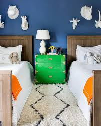lit boys room beautifully decorated shared boys bedroom features a green campaign dr
