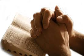 Image result for praying hands over bible
