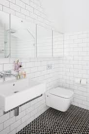 bathroom white tiles: captivating interior bathroom using white wall tile also sink and toilet