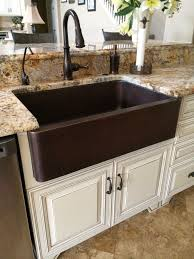 hammered copper kitchen sink: hammered copper farm sink moen oil rubbed bronze touch less faucet
