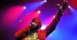 Masked rapper MF <b>Doom</b> dies at 49