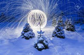 image of beautiful lighting works display in a natural setting with lots of snow and christmas beautiful lighting