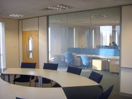 combined office interiors interior oval black and white table combined with blue chairs also glass wall blue office room design