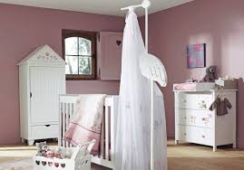 sweet pink and white baby girl nursery room with contemporary white wood vanity furniture also charming baby furniture design ideas wooden