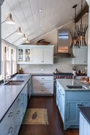 pendant lighting for sloped ceilings exciting metal wall sconces with windows above sink next to 2 bathroom fans middot rustic pendant