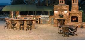 patio outdoor stone kitchen bar: fair stone outdoor kitchen divine outdoor kitchen with fireplace stone outdoor fireplace surround stone storage logs curved shape stone outdoor kitchen island metal stools stainless steel built in grills built in storage pantry
