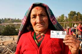 80 year old Ratna Maya Thapa comes to Dolakha, Central Region, Nepal to vote after walking for 1 1/2 hours. She proudly shows her voter card. - Nepal-woman-voter