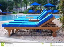 lounge patio chairs folding download: chaise lounge chairs by the pool stock image image