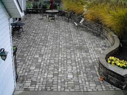 stone patio installation: stone wall amp stone patio installation by hoehnen landscaping in chagrin falls oh