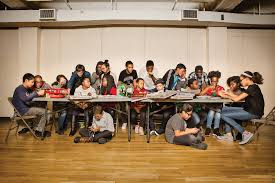 a group of american teens are excelling at advanced math the an end of semester board game party in manhattan for students of the bridge to enter advanced mathematics program beam teaches new york city kids from