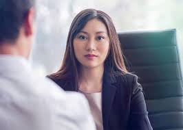 Should you use a job offer as leverage to negotiate for a raise? Woman at job interview.