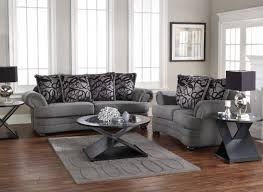 classy living room furniture sets applying grey color with oval glass table on thick rug and furnished with table lamps on round nightstands astonishing living room furniture sets elegant